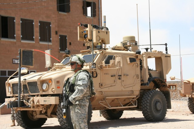 A Soldier from 2nd Brigade, 1st Armored Division stands before a Warfighter Information Network-Tactical (WIN-T) Increment 2 Point of Presence (PoP) on May 17, 2012 during the WIN-T Increment 2 Initial Operational Test and Evaluation (IOT&E) at White Sands Missile Range, N.M.