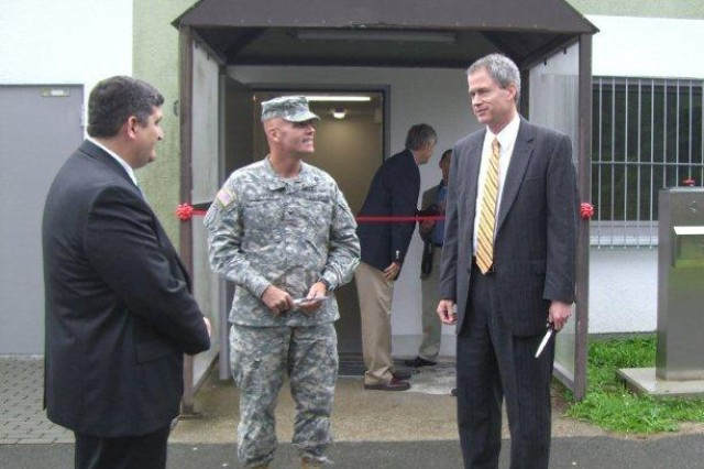 Attendees at the ribbon-cutting ceremony in the Kaiserslautern military community include, from left, Lee Roberts, director of Region Europe; Col. Ronald Green, 405th AFSB; and James Johnson, USATA executive director.