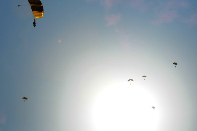 "Members of the Golden Knights' ""Black Team"" descend onto Rock Island Arsenal July 7 to close Rock Island Arsenal's 150 Anniversary Celebration. (Photo by Jon Connor, ASC Public Affairs)"