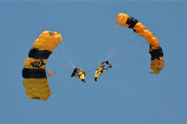 Members of the U.S. Army Parachute Team, the Golden Knights, perform a spinning maneuver while connected to each other during the Rock Island Arsenal's 150th Anniversary Celebration July 7. The Golden Knights have been representing the Army since 1959 and have won numerous national and world championships. (Photo by Galen Putnam, ASC Public Affairs)