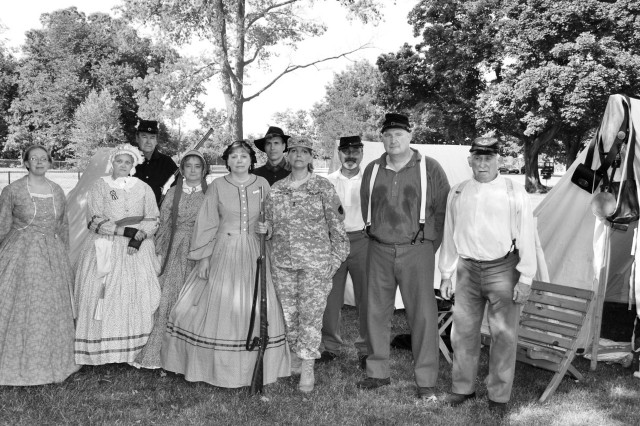 Maj. Gen. Patricia E. McQuistion poses with the Civil War Encampment group. (Photo by Bonnie Seals, ASC Public Affairs)