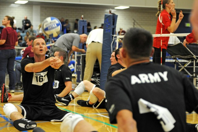 Members of the U.S. Army sitting volleyball team warm up before their game against the Marines during the 2012 Warrior Games, May 1, 2012, at the U.S. Air Force Academy in Colorado Springs, Colo.