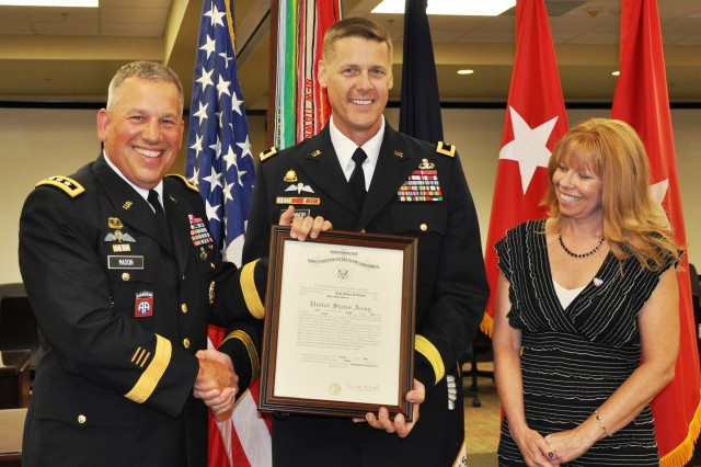 "FORT BRAGG, N.C. (July 11, 2012)  Lt. Gen. Raymond V. Mason (left), the U.S. Army's deputy chief of staff for Logistics, newly promoted Maj. Gen. John R. ""Jack"" O'Connor, U.S. Army Forces Command's deputy chief of staff-G4 (Logistics), and Andree O'Connor pose with O'Connor's promotion certificate. Mason, who is now the Army's senior logistician, was O'Connor's predecessor at FORSCOM."