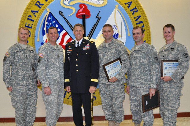 "FORT BRAGG, N.C. (July 11, 2012)  U.S. Army Forces Command's Deputy Chief of Staff-G4 (Logistics) Maj. Gen. John R. ""Jack"" O'Connor poses with members of The Army Ground Forces Band's brass quintet after presenting them with certificates of appreciation for their outstanding performance during his promotion ceremony. The FORSCOM band's Soldier/musicians are (l-r) 1st Sgt. James Freeman, Sgt. 1st Class Tom MacTaggart, Staff Sgt. Frank Briscoe, Sgt. James Newcomb, and Spc. Tristan Calabrese."