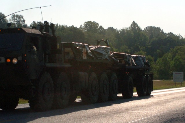 Palletized Load System trucks from the 733rd Transportation Company, out of Reading, Pa., leave Crane Army Ammunition Activity, Ind., carrying deactivated 2,000-pound bombs as part of a convoy during Operation Golden Cargo 2012.