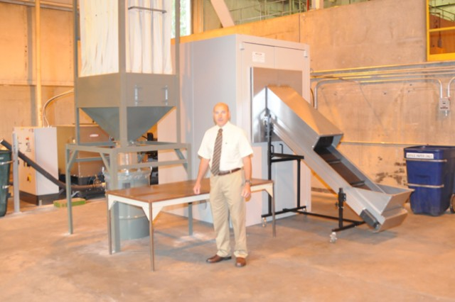 Ralph Hawn, security specialist with the security division of the Directorate of Plans, Training, Mobilization and Security, explained both the workings and the benefits of the newly assembled disintegrator at the Fort Rucker Recycling Center July 6.