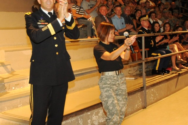 """Maj. Gen. Michael S. Linnington, commanding general of MDW and a Soldier from The U.S. Army Band """"Pershing's Own"""" fires up the crowd during the """"Twilight Tattoo"""" on July 11, 2012 at Joint Base Myer-Henderson Hall."""