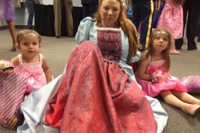 Olivia Bronwyn Hall, 2, (left), holds court with Spc. Elizabeth Riehm, Fort Wainwright Better Opportunities for Single Soldiers president, and her sister, Aubry Ruth Hall, 4, during the Father-Daughter Ball, Saturday. The siblings, or princesses, were escorted by their knight in shining armor, Capt. Timothy Hall, (not pictured) commander U.S. Army Garrison, Headquarters and Headquarters Company. Festivities were hosted by the Armed Services YMCA. (Photo by Cynda Cherish, ASYMCA).