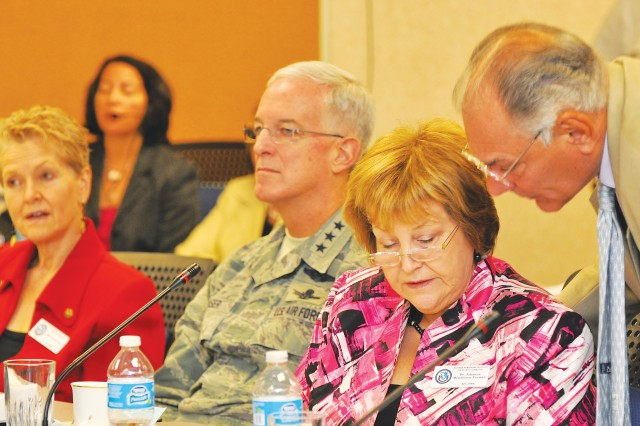 Chairwoman Johanna Mendelson-Forman (center) confers with member Ambassador Peter Romero during the board of visitors meeting June 28 at the Institute. To her left are board members Ambassador Swanee Hunt, from Harvard's Kennedy School of Government, and Gen. Douglas Fraser, commander of U.S. Southern Command.