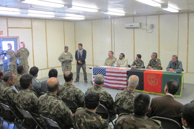 Col. Debra Grays, Theater Transition Team chief, speaks during the transfer ceremony in which FOB Dubs was officially turned over the Government of the Islamic Republic of Afghanistan. It is expected that the base will be used by the Afghan National Army.