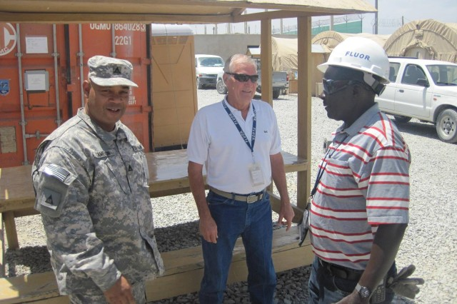 Tony Cameron, LOGCAP plans liaison officer, Wesley Parker, Fluor site lead for FOB Dubs and Foreman Kilonzo following the ceremony June 30, 2012, to transfer the base to the Government of the Islamic Republic of Afghanistan.