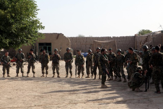 Afghan National Army soldiers prepare to leave on patrol after a short water resupply stop during Operation Gospand-Sia in the Sangin Valley District, July 11, 2012. The Afghan-led operation was scheduled for 48 hours, but ANSF destroyed several IEDs and one weapons cache and cleared all of their objectives in less than 16 hours.