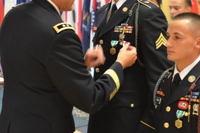 FORT BRAGG, N.C. (July 12, 2012) - Maj. Gen. John R. O'Connor, U.S. Army Forces Command deputy chief of staff, G-4 (Logisitics), pins the Meritorius Service Medal on to the uniform of Sgt. Dariuz Krzywonos, the 2012 FORSCOM Noncommissioned Officer of the Year.  Krzywonos is assigned to Headquarters and Headquarters Battery, 2nd Battalion, 12th Field Artillery Regiment, 4th Brigade Combat Team (Stryker), 2nd Infantry Division.  Also pictured is Spc. Jeremy Shivick, the 2012 Soldier of the Year.