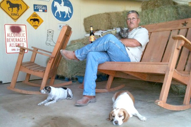 Col. Shane Dietrich enjoys a little down time with his animals while at his home near Copperas Cove, Texas, where he and his wife care for three horses, two Beagles, a tarrier, cat, chickens and a rooster.