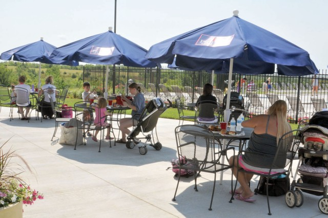 Families enjoy an old-fashioned Family picnic July 2 during the grand opening of the Ellis Heights Neighborhood Center at Fort Riley, Kan. The center provides several amenities, including a club room, a media area and an Olympic-sized pool.
