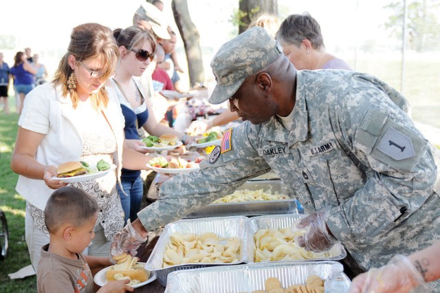 USO Fort Riley volunteers hand out free food to Fort Riley Families during a USO Fort Riley No Dough Dinner June 28 at the Fort Riley Recycling Center, Fort Riley, Kan.