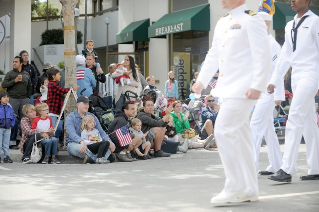 "PRESIDIO OF MONTEREY, Calif. "" Well-wishers cheer on sailors as the march along Alvarado Street in downtown Monterey, July 4."