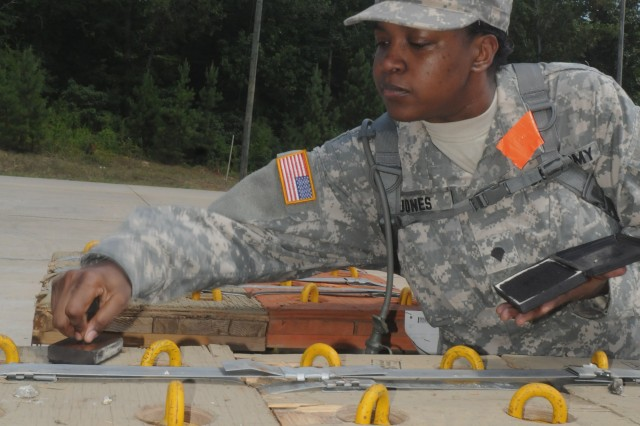 Spc. Delishia R. Jones, a stock control ammunition specialist from Rockford, Ill., assigned to the 826th Ordnance Company (Task Force Hellcat) marks pallets of 155mm artillery ammunition at the Anniston Army Depot July 9, before they are transported nearly 500 miles as part of Operation Golden Cargo 2012.