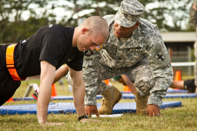 Pfc. Jose Figueroa, equipment parts and records specialist for the 536th Support Maintenance Company, 45th Sustainment Brigade, 8th Theater Sustainment Command, completes his pushups for the physical fitness test during the 8th TSC's Best Warrior Competition, at Area X on Schofield Barracks, May 8.