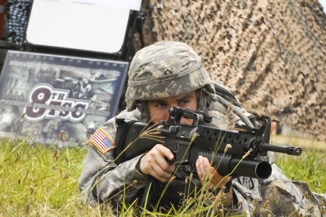 Pfc. Jose Figueroa (top), equipment parts and records specialist for the 536th Support Maintenance Company, 45th Sustainment Brigade, 8th Theater Sustainment Command, pulls security during the warrior tasks at the 8th TSC's Best Warrior Competition, at Area X on Schofield Barracks, May 8.
