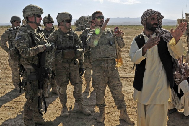 From left, Maj. Roger Shaw, 3rd Stryker Brigade Combat Team, 2nd Infantry Division, and Maj. Gregory Sakimura, 1st Battalion, 17th Infantry Regiment, 2nd Infantry Division, speak with the local Afghan Border Police during Operation Buffalo Thunder II near Baradge Kotal, Afghanistan, June 29, 2012. During the eight-day mission, Afghan and American forces cleared more than 120 kilometers of rugged terrain and escorted approximately 60 truckloads of humanitarian aid for distribution to the people of Shorabak.