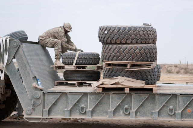 FORWARD OPERATING BASE WARRIOR, Afghanistan -- U.S. Army Pfc. Taj Boyd, a truck driver with the 82nd Airborne Division's 1st Brigade Combat Team, secures a load of tires for the return leg of a combat logistics patrol July 9, 2012, Ghazni Province, Afghanistan.  Boyd is assigned to 307th Brigade Support Battalion. (U.S. Army photo by Sgt. Michael J. MacLeod, Task Force 1-82 PAO)