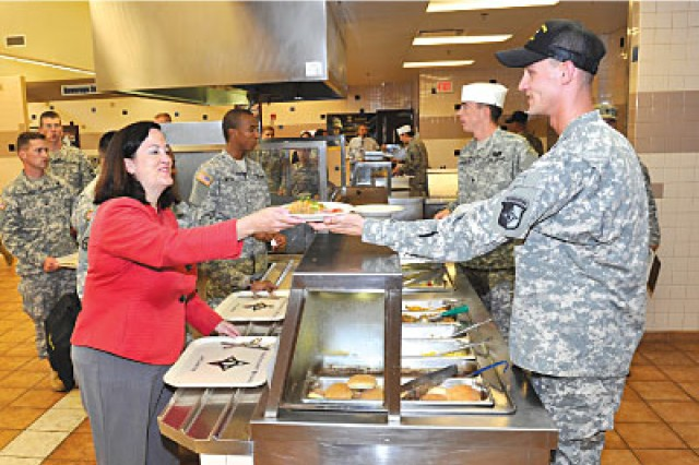 Assistant Secretary of the Army for Installations, Energy, and Environment Katherine Hammack visited and dined with Soldiers at the 101st Sustainment Brigade Dining Facility during a visit to Fort Campbell, 10 July, 2012.