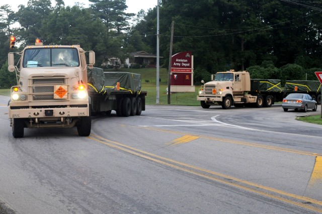 Armored M915A3 trucks from the 432nd Transportation Company, 828th Transportation Battalion (Task Force Hellcat), depart Anniston Army Depot, Ala., July 10, 2012, carrying pallets of high-explosive 155mm artillery shells bound for the Crane Army Ammunition Activity in Crane, Ind., as part of Operation Golden Cargo 2012.
