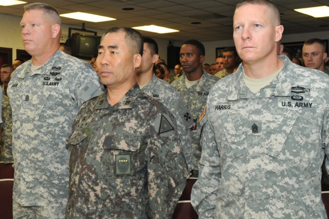 (From the left) Eighth Army Wightman NCO Academy Commandant Command Sgt. Maj. William C. Baker, Republic of Korea Army Sergeant Major of the Army Jeong Hae-cheon and Eighth Army Command Sgt. Maj. Rodney D. Harris attend a ceremony July 16, 2012, to establish a combined training program.