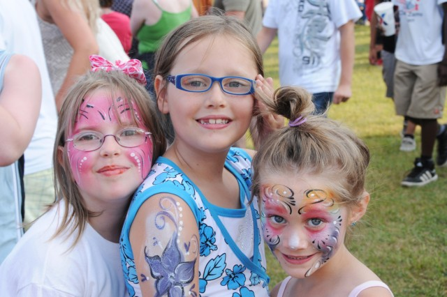 Sabrina Whyno, 7, Roseellen Short, 8, and Gabby Short, 6, (left to right) show off their face and arm painting.