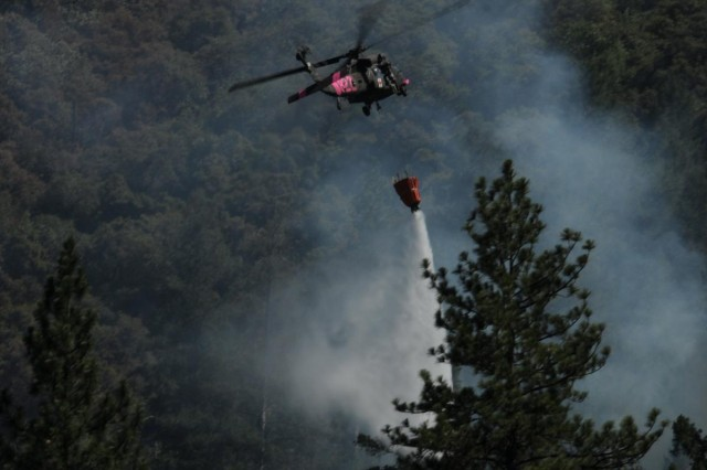 A California Army National Guard UH-60 Black Hawk drops water, July 14, 2012, on a portion of the Robbers Fire in Placer County, Calif. The California Army National Guard worked with Cal Fire to control the fire by dropping thousands of gallons of water, in addition to providing medical evacuation support.