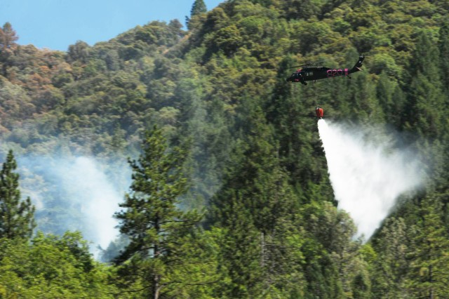 California Army National Guard helicopter drops water on Robbers Fire