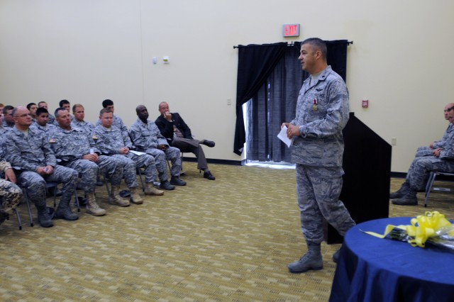 """EL PASO, Texas """" U.S. Air Force Lt. Col. Adrian N. Clarke, outgoing commander for the 7th Air Support Operations Squadron, speaks to a group during his change of command ceremony at Fort Bliss, Texas, July 13, 2012. Clarke is a native of Las Cruces, N.M., and has been commander of the 7th ASoS """"Hustlers,"""" since July 2010. (U.S. Army photo by Sgt. Richard Andrade, 16th Mobile Public Affairs Detachment)"""
