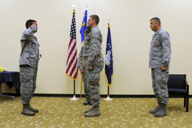 """EL PASO, Texas """" U.S. Air Force Lt. Col. Haider A. Khan, (left), deputy commander for the 3rd Air Support Operations Squadron, based out of Fort Hood, Texas, salutes Lt. Col. Timothy M. Cullen, incoming director of operations for the 7th ASoS, while the outgoing commander, Lt. Col. Adrian N. Clarke, (right) stands at attention, during a change of command ceremony held at Fort Bliss, Texas, July 13, 2012. Clarke has been commander of the 7th ASoS """"Hustlers,"""" since July 2010 (U.S. Army photo by Sgt. Richard Andrade, 16th Mobile Public Affairs Detachment)"""