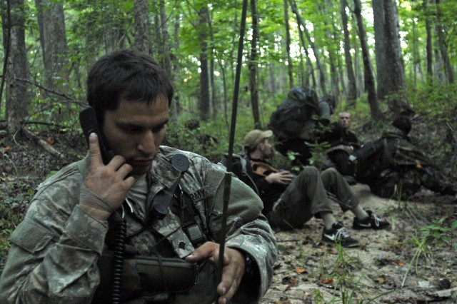 A Special Forces Qualification Course student participating in the Robin Sage training exercise attempts to make radio contact with members of his detachment. Robin Sage is the final exercise in the SFQC before students are allowed to graduate the course and don their green berets. (U.S. Army photo by Sgt. Derek Kuhn, 40th Public Affairs Detachment.)