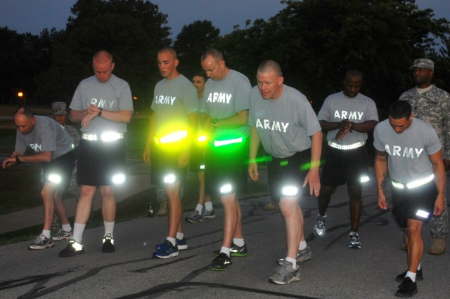 After competing in push-ups and sit-ups, the AMC Soldiers went out outside for the next event, the 2-mile run July 16. Sgt. 1st Class Jay Denton (fourth from left leaning), Army Sustainment Command NCO of the Year, anticipates the start of the run. The last day of competition is July 18. (Photo by Bonnie Seals, Army Sustainment Command Public Affairs)