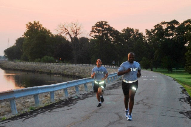 Army Materiel Command Soldiers run along the Mississippi River on Rock Island Arsenal, Ill., during the 2-mile run of the Army Physical Fitness Test July 16. After getting cleaned up, the next event was a board appearance, followed by an essay writing/written exam, and then the day/night urban orienteering course. (Photo by Bonnie Seals, Army Sustainment Command Public Affairs)