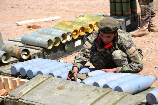 An Afghan National Army soldier cleans artillery rounds during Operation Eagle's Flight, an ANA artillery validation exercise held at Patrol Base Sorkh Bid, Afghanistan, July 11, 2012.