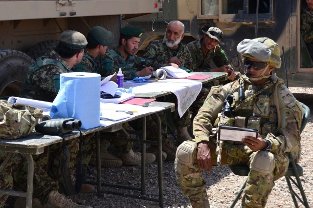 Australian Capt. Raj Chetty assesses Afghan National Army soldiers on their targeting skills during Operation Eagle's Flight, an ANA artillery validation exercise held at Patrol Base Sorkh Bid, Afghanistan, July 11, 2012.