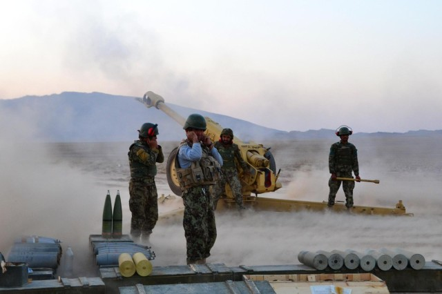 Afghan National Army soldiers cover their ears after a blast from a D30 Howitzer during Operation Eagle's Flight, an ANA artillery validation exercise held at Patrol Base Sorkh Bid, Afghanistan, July 11, 2012.