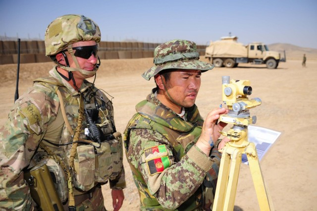 Warrant Officer Class 2 Nathan Cole supervises Sgt. Ibrahim from the Afghan National Army on the aiming circle during Exercise Eagle's Flight at Patrol Base Sorkh Bid,Afghanistan.