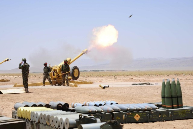 Gunners from the Afghan National Army fire a D-30 Artillery piece outside Patrol Base Sorkh Bid, Afghanistan, during Exercise Eagle's Flight.