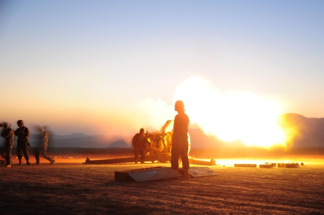 Gunners from the Afghan National Army fire a D-30 Artillery piece during a night mission at Patrol Base Sorkh Bid, Afghanstan, during Exercise Eagle's Flight.