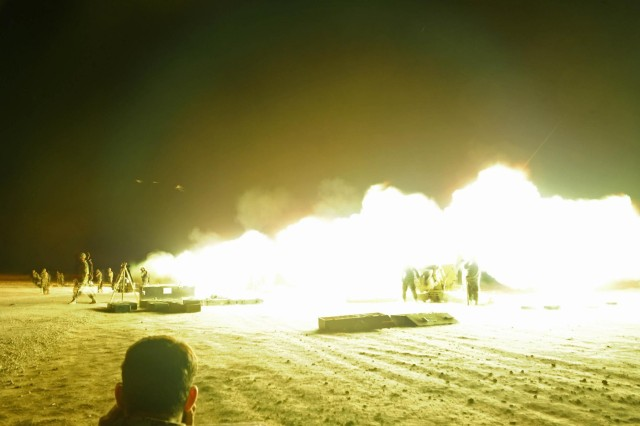 Gunners from the Afghan National Army fire multiple D-30 Artillery pieces during a night mission at Patrol Base Sorkh Bid during Exercise Eagle's Flight.