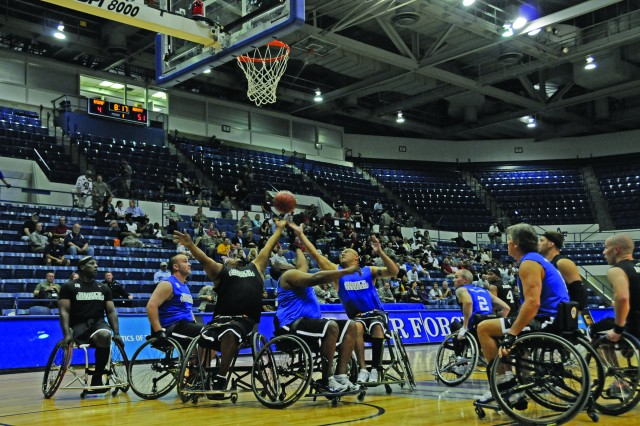 The Army's team competes in the May 2 wheel chair volleyball event during the Warrior Games, defeating the Air Force team 57-6. Many Soldiers who serve in the Continuation on Active Duty Program are involved in alternative sports programs at Warrior Transition Units.