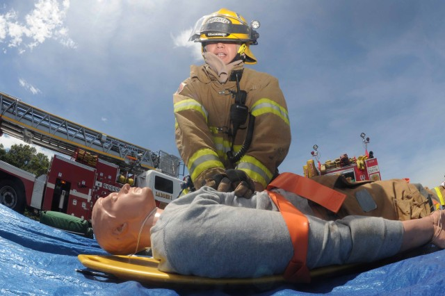 A member of the Camp Zama Fire Department administers CPR to a training dummy as part of his first-responder requirements during a mock scenario here involving a downed aircraft and several injured personnel on the first day of a full-scale exercise, the first of its kind to be held on the installation.