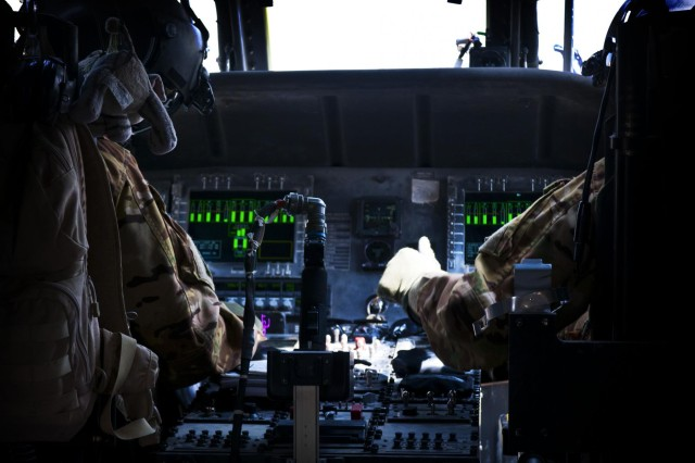 Chief Warrant Officer 3 Jason Bouchard (left), 35, of Redlands, Calif., and 1st Lt. June Ciaramitaro, 26, of Fort Worth, Texas, prepare a UH-60 Black Hawk medevac helicopter for take-off on Forward Operating Base Salerno, Afghanistan, July 8, 2012.