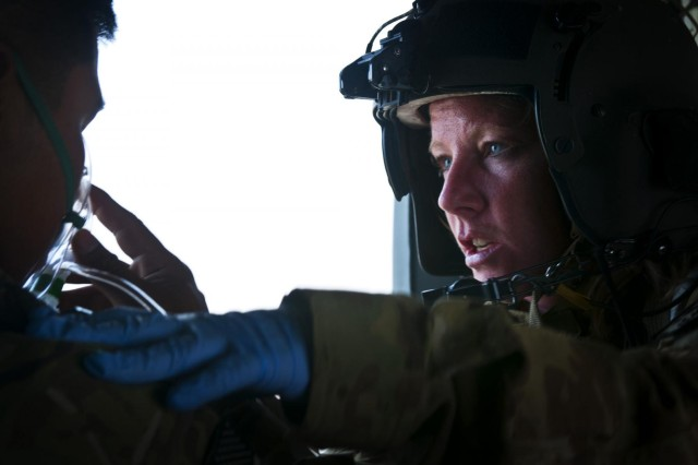 Staff Sgt. Erin Gibson, 31, of Covington, Ohio, adjusts and oxygen mask on a medevac patient in Logar province, Afghanistan, July 8, 2012. Gibson is a flight medic serving with Task Force Corsair, 82nd Combat Aviation Brigade, on Forward Operating Base Shank.