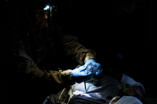 Staff Sgt. Erin Gibson, 31, of Covington, Ohio, places an oxygen mask on a medevac patient injured in an improvised explosive device blast in Wardak province, Afghanistan, July , 2012. Gibson is a flight medic serving with Task Force Corsair, 82nd Combat Aviation Brigade, on Forward Operating Base Shank.