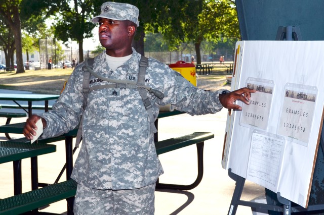 Staff Sgt. Robert Wilkins, noncommissioned officer-in-charge of the Daytime Urban Orienteering event of the Army Materiel Command Best Warrior Competition, briefs competitors before releasing them to locate 10 points sprinkled across Rock Island Arsenal, Ill., July 16. Participants had three hours to locate as many points as possible on the 946-acre island on the Mississippi River.